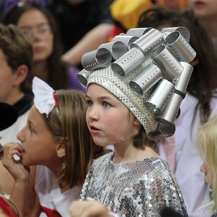 Photo of girl dressed up in silver costume for performance